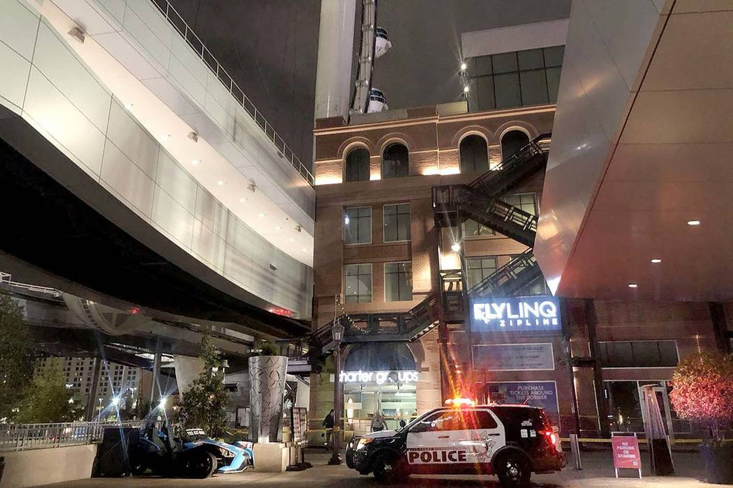 A police car is seen near the High Roller in Las Vegas, Friday, Feb. 15, 2019, after a man fall ...