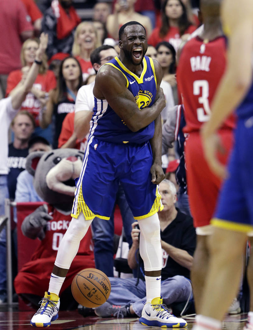 Golden State Warriors forward Draymond Green (23) reacts after a play during the second half in ...