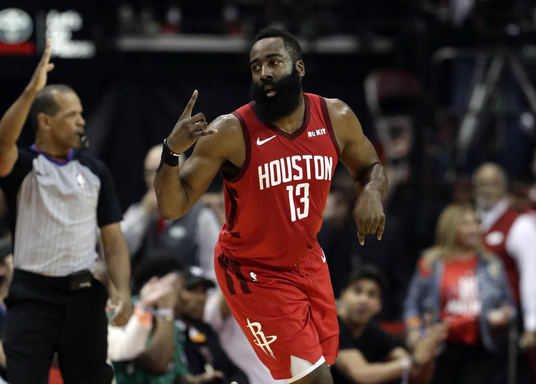 Houston Rockets' James Harden (13) celebrates a basket against the Golden State Warriors during ...