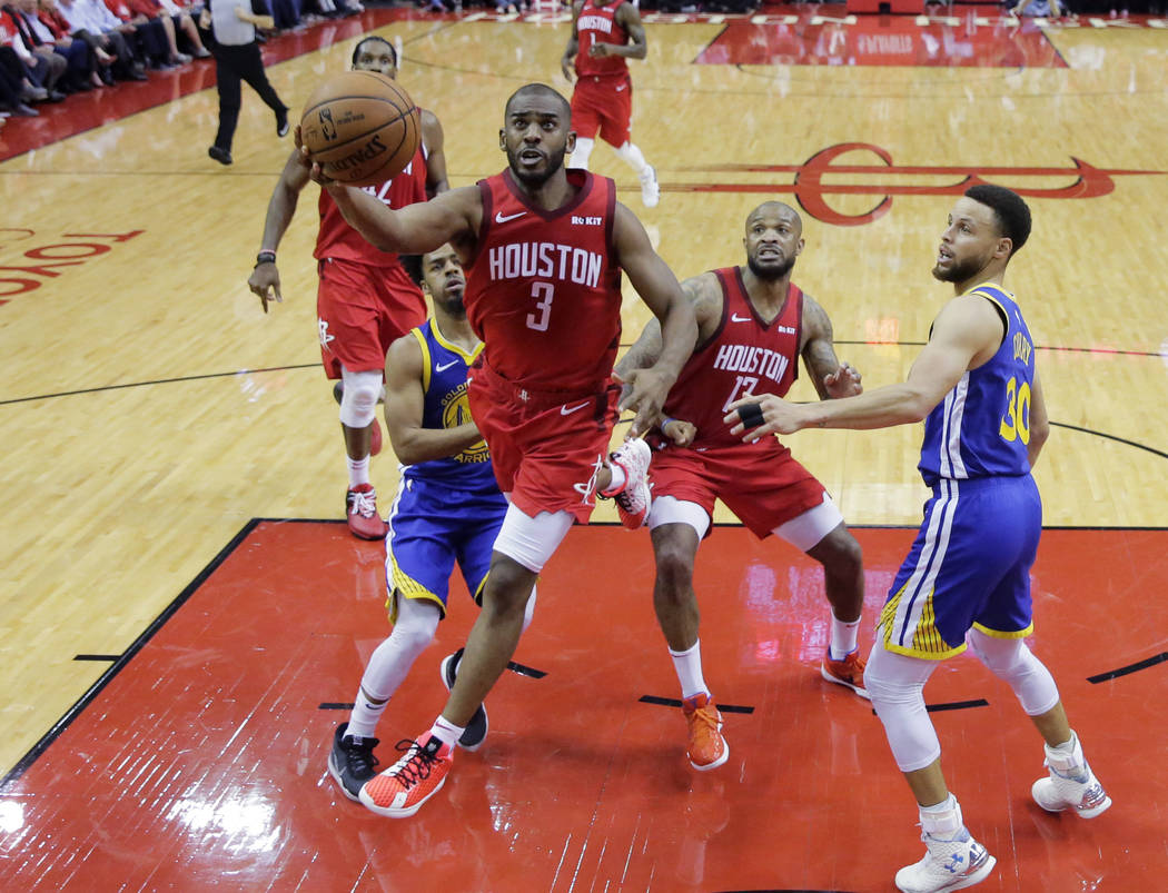 Houston Rockets guard Chris Paul (3) drives past Golden State Warriors guard Stephen Curry (30) ...