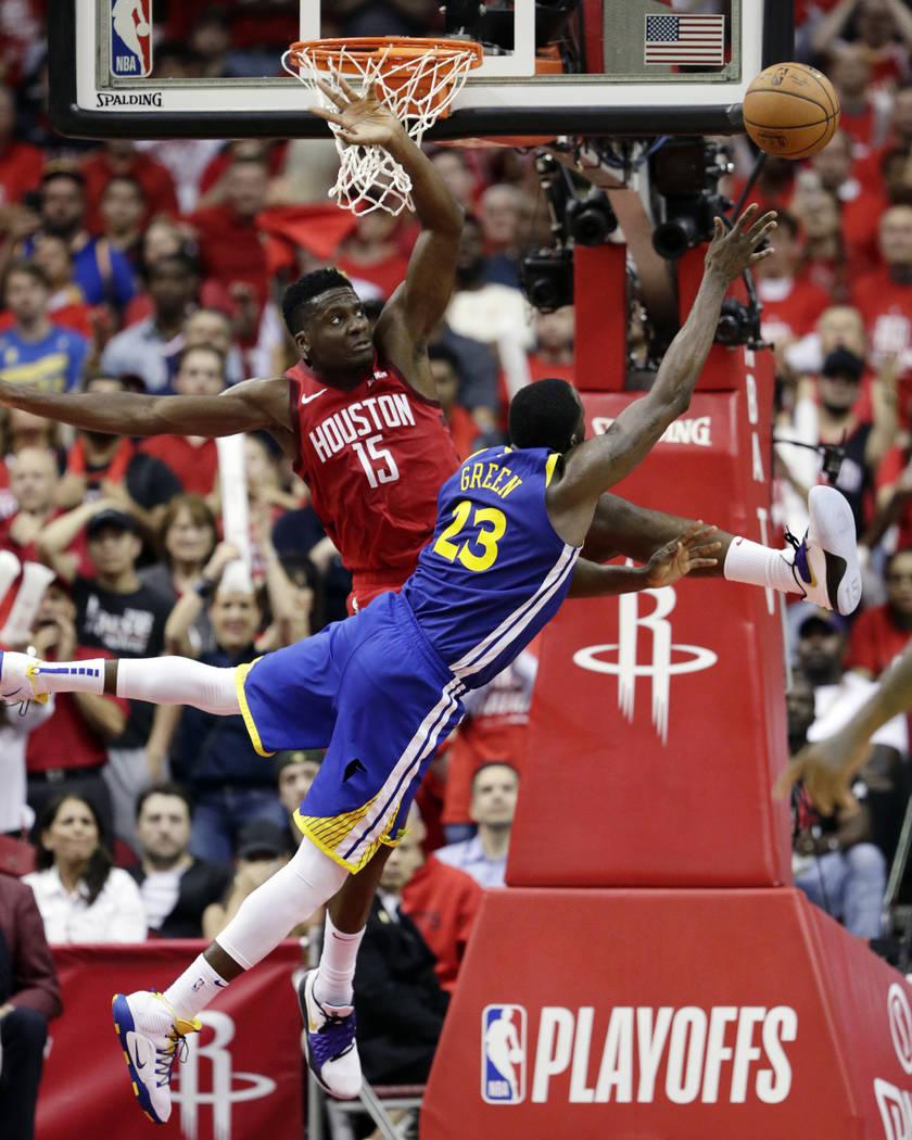 Golden State Warriors forward Draymond Green (23) shoots asHouston Rockets center Clint Capela ...