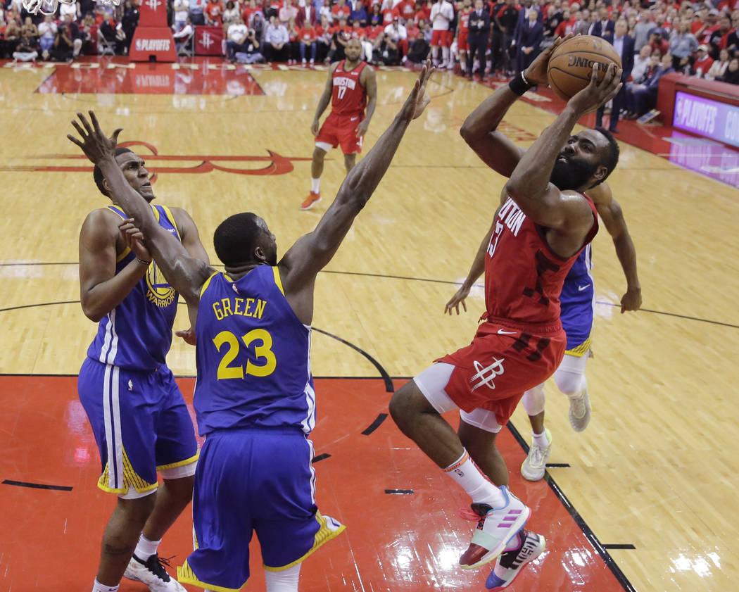 Houston Rockets guard James Harden (13) shoots over Golden State Warriors forward Draymond Gree ...