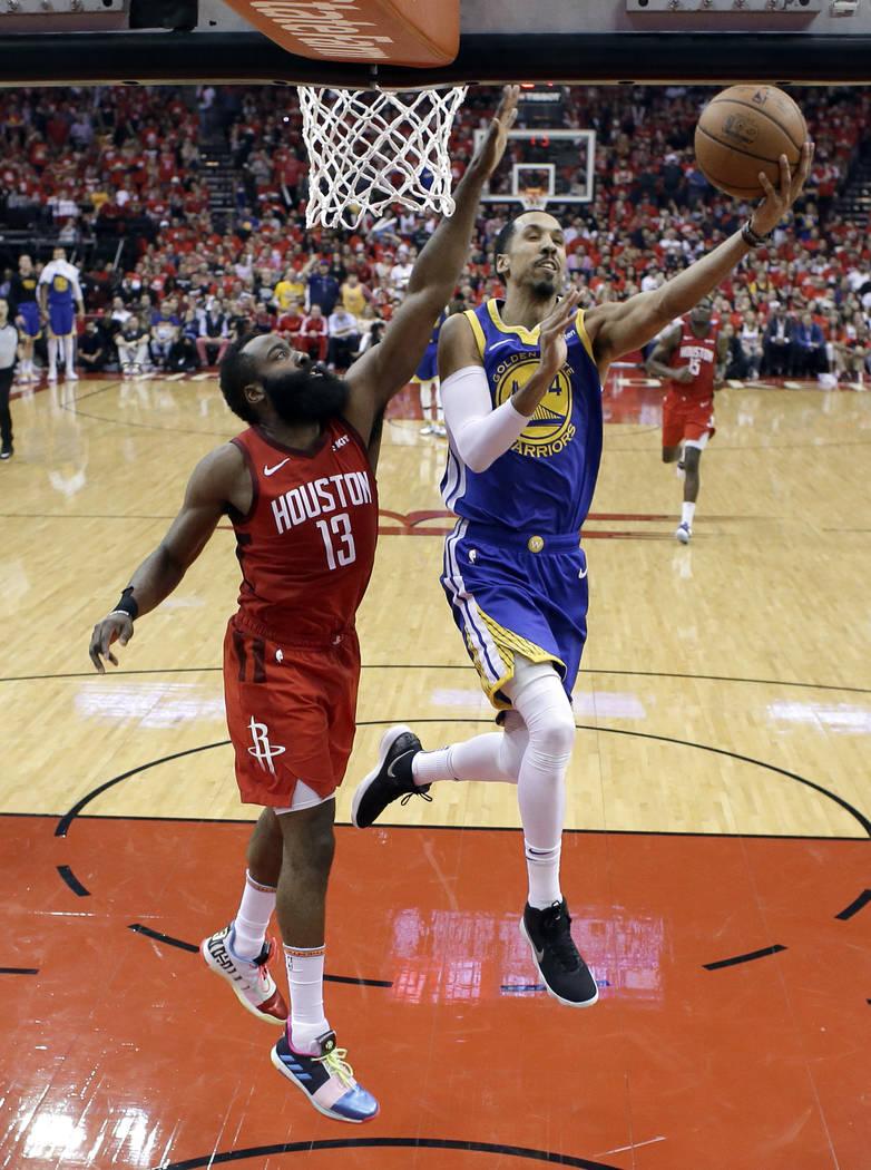 Houston Rockets' James Harden (13) defends as Golden State Warriors' Shaun Livingston goes up f ...