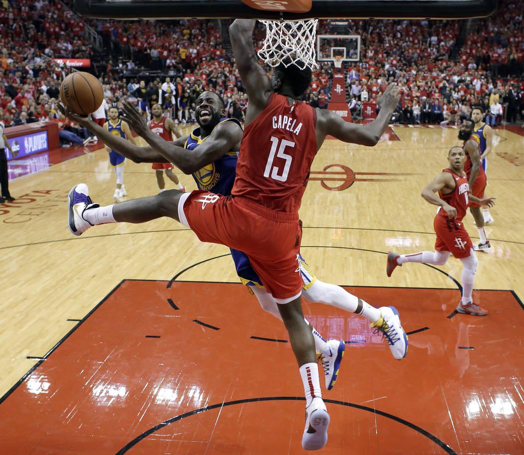 Golden State Warriors' Draymond Green (23) goes up for a shot as Houston Rockets' Clint Capela ...