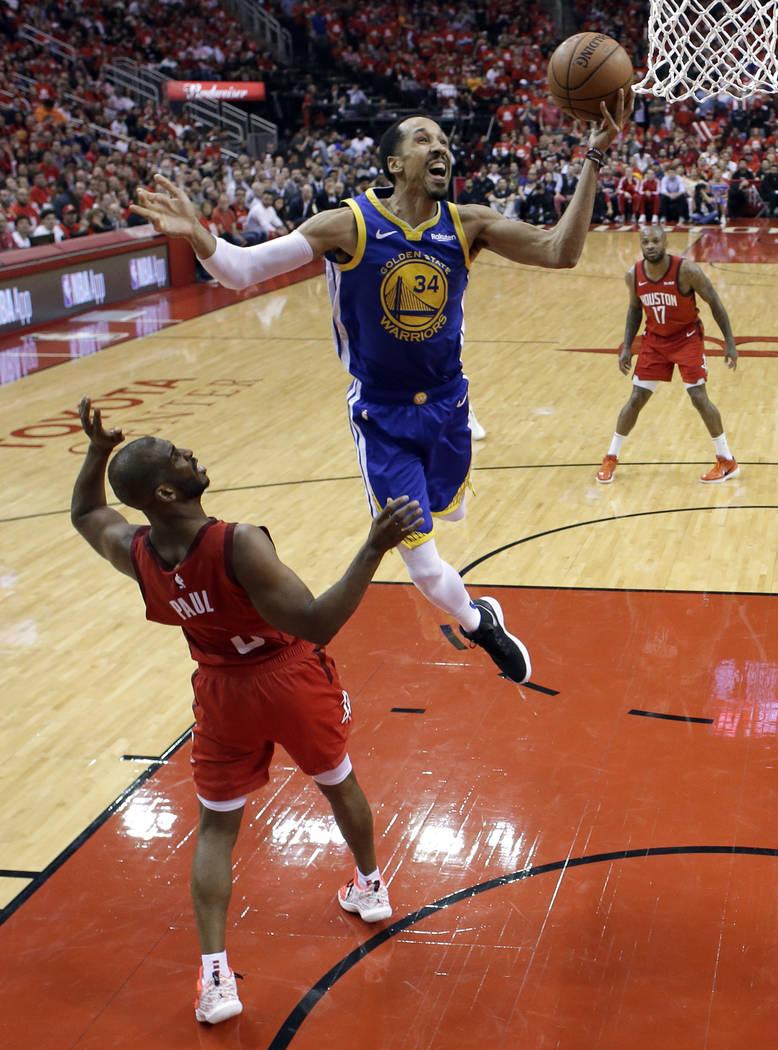 Houston Rockets' Chris Paul (3) defends as Golden State Warriors' Shaun Livingston (34) goes up ...