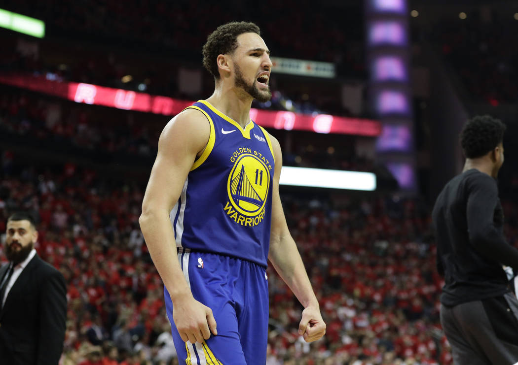 Golden State Warriors guard Klay Thompson celebrates the team's win over the Houston Rockets in ...