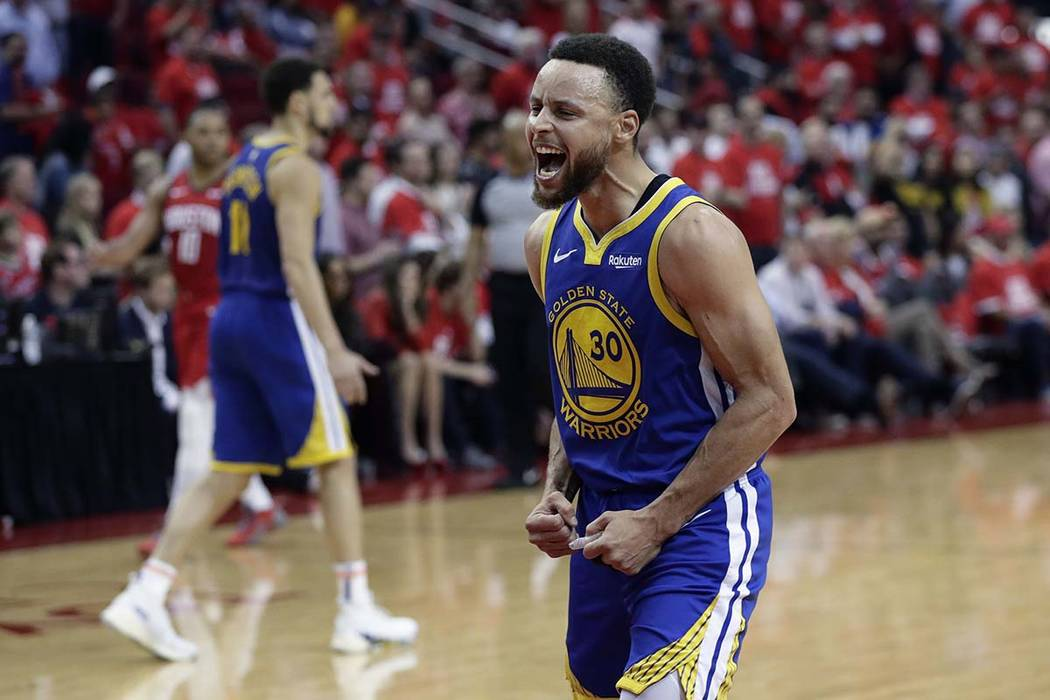 c8bf1ad2f73b Golden State Warriors guard Stephen Curry (30) celebrates the team s win  over the Houston
