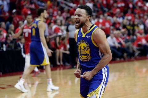 Golden State Warriors guard Stephen Curry (30) celebrates the team's win over the Houston Rocke ...