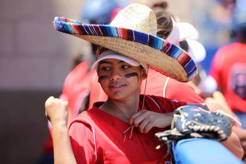 Coronado's Valeria Bermudez (14) stands in the dugout wearing a sombrero during the Southern Ne ...