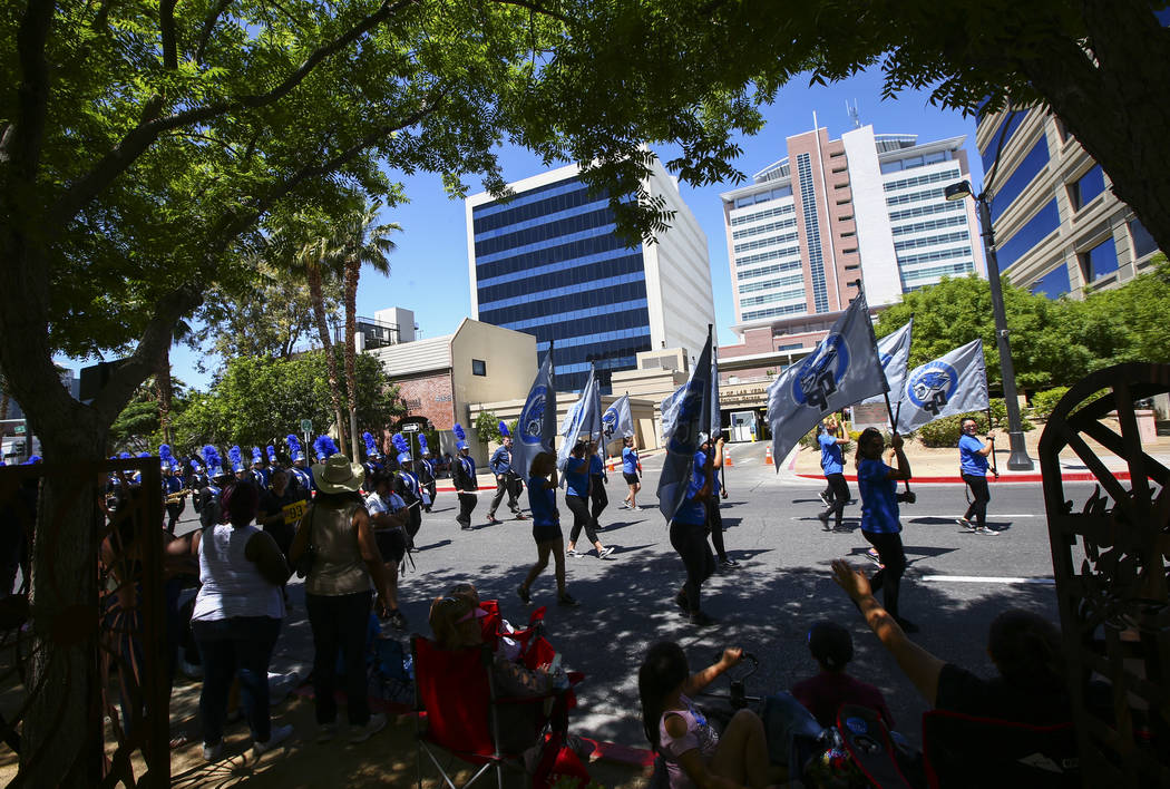 Members of the Desert Pines High School marching band participate in the Helldorado Parade alon ...