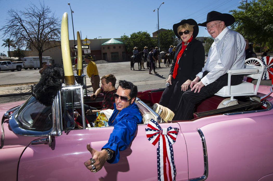 Elvis impersonater Jesse Garon, left, poses for a photographer with Mayor Carolyn Goodman, cent ...