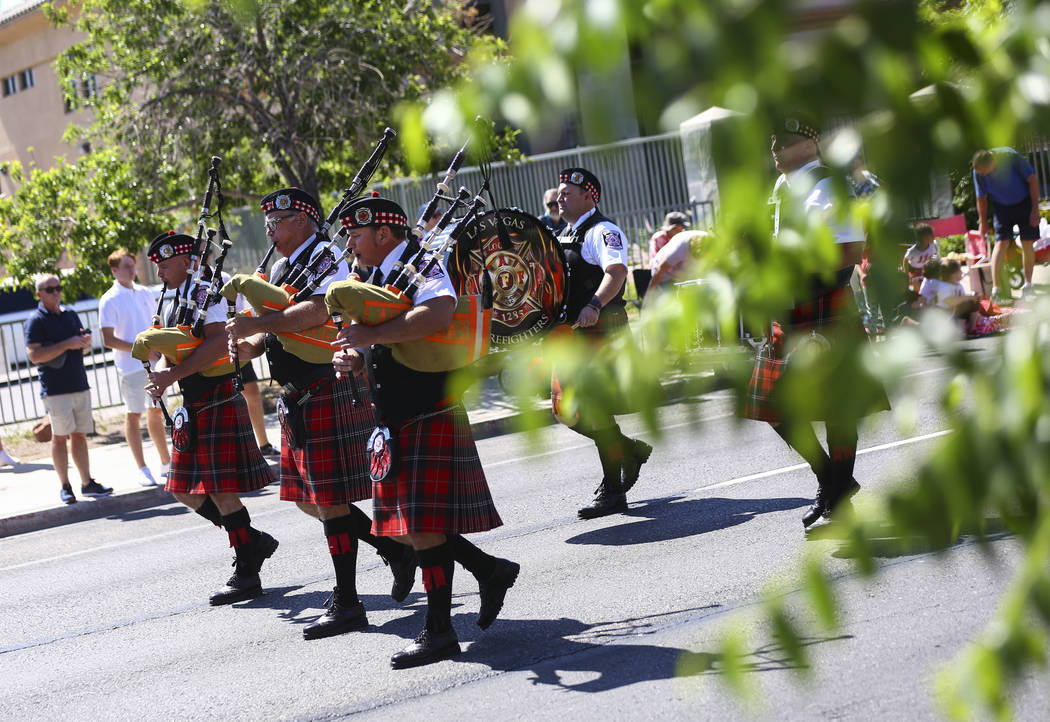 Members of the Las Vegas firefighters pipe & drum band perform during the Helldorado Parade ...
