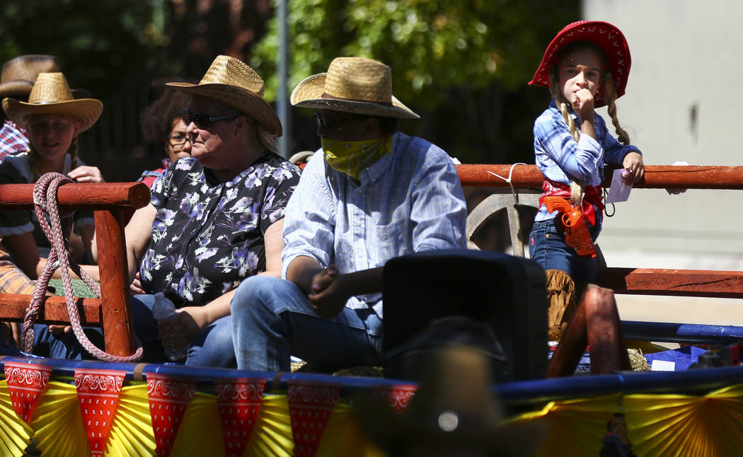 Participants on the Del Sol Academy of the Performing Arts float wear western attire during the ...