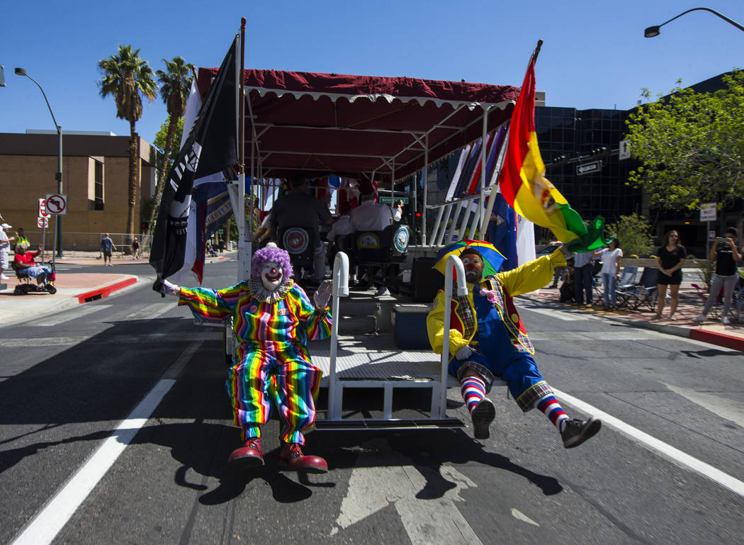 Zelzah Shrine Clowns wave to the crowd during the Helldorado Parade along Fourth Street in down ...