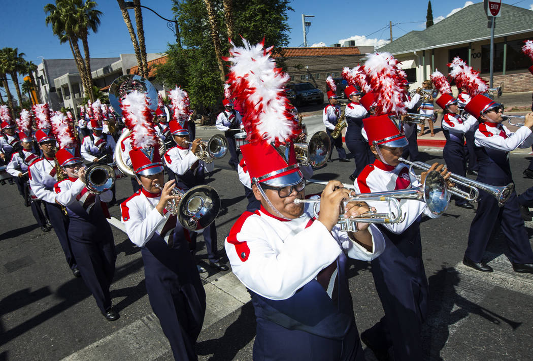 Members of the Valley High School marching band perform during the Helldorado Parade along Four ...