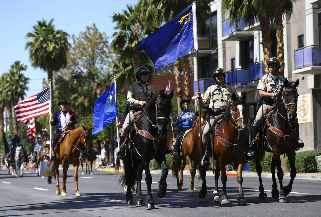 Las Vegas police officers participate in the Helldorado Parade along Fourth Street in downtown ...