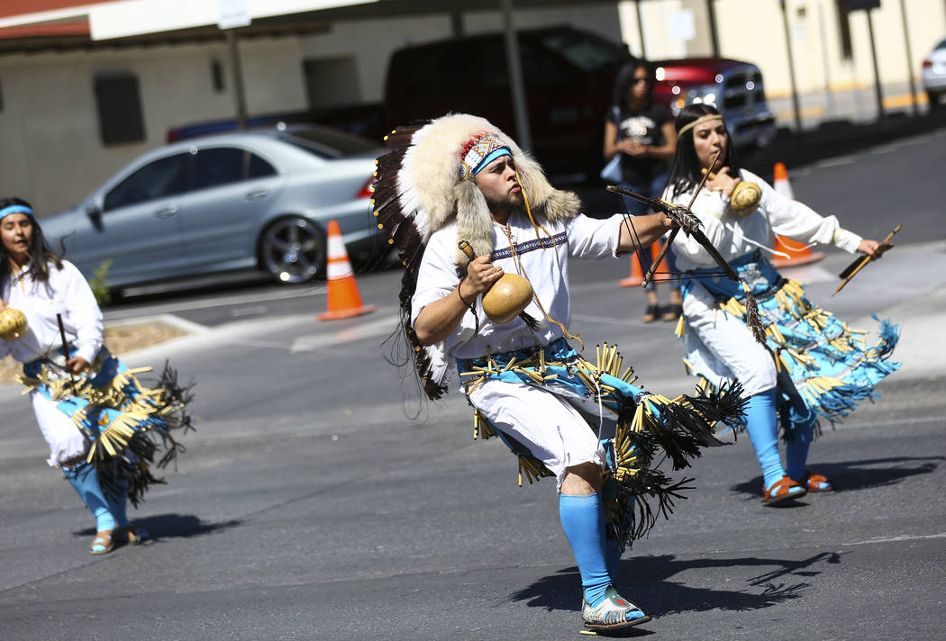 Members of Danza del Carrizo perform during the Helldorado Parade along Fourth Street in downto ...