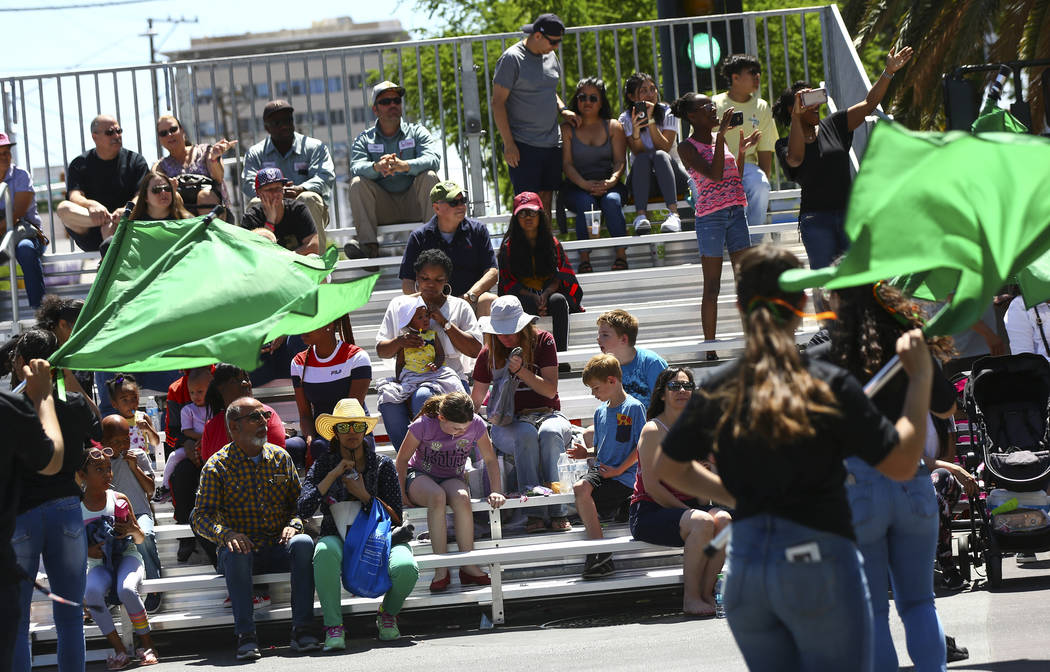 Attendees watch performers from Mojave High School during the Helldorado Parade along Fourth St ...