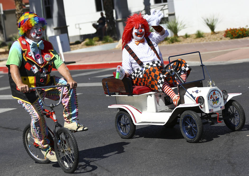 Members of the Zelzah Shrine Clowns participate in the Helldorado Parade along Fourth Street in ...