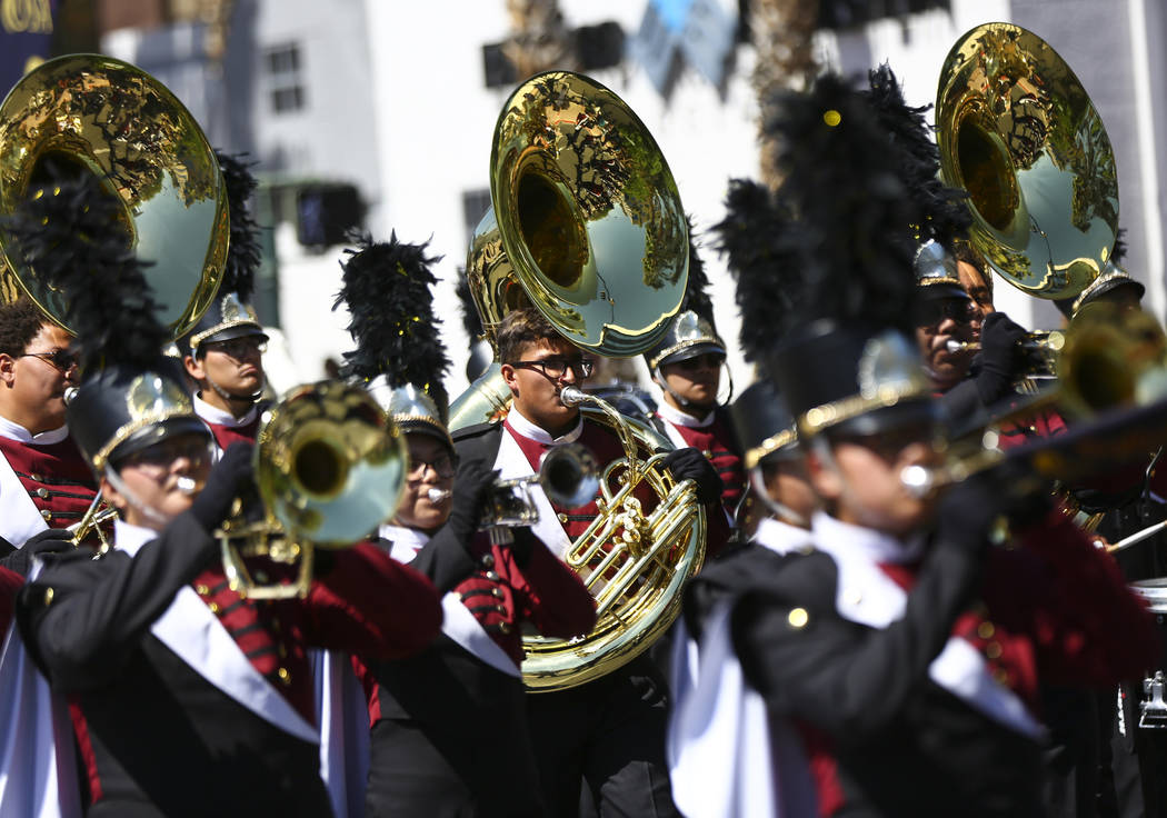 Members of the Del Sol marching band perform during the Helldorado Parade along Fourth Street i ...