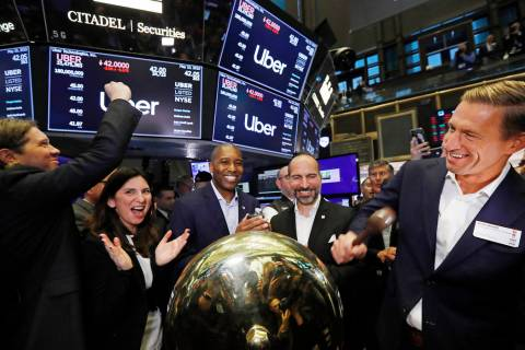 In this Friday, May 10, 2019 file photo, Uber board member Ryan Graves, right, rings a ceremoni ...