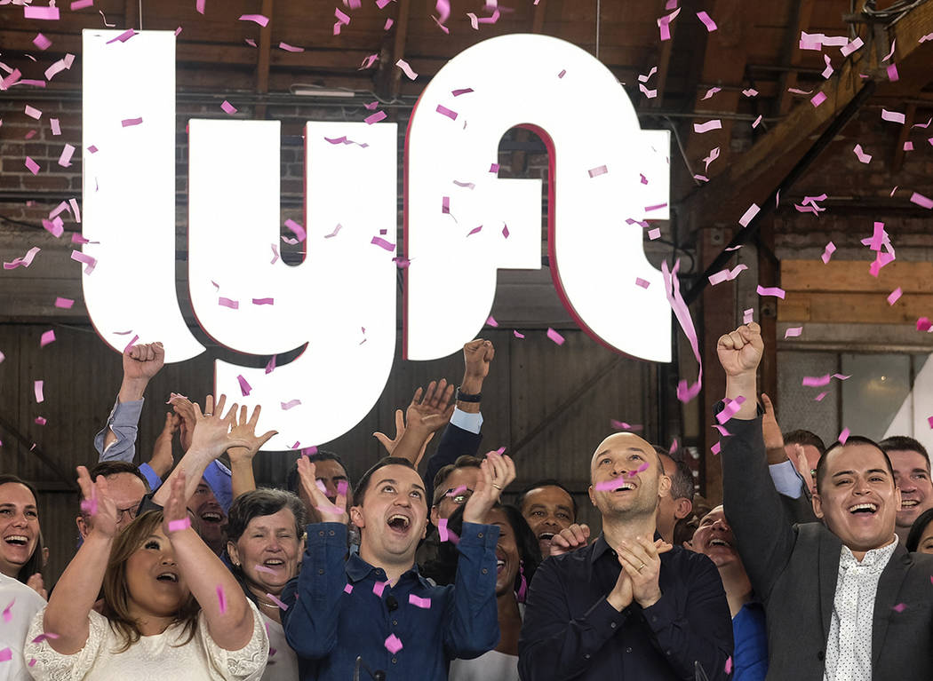 In this Friday, March 29, 2019 file photo, Lyft co-founders John Zimmer, front second from left ...