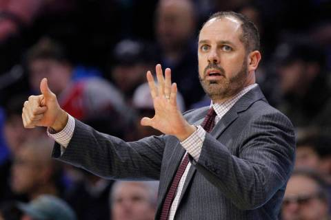 Orlando Magic coach Frank Vogel signals from the sideline during the team's game against the Ph ...
