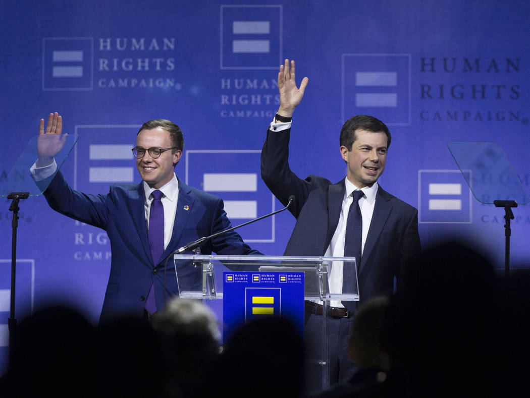 Democratic presidential candidate Pete Buttigieg, right, and husband Chasten Glezman wave to th ...