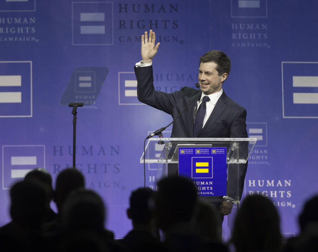 Democratic presidential candidate Pete Buttigieg waves to the audience at the 14th Annual HRC L ...