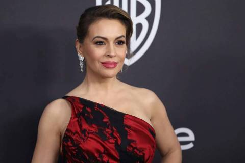 In this Jan. 6, 2019 file photo, Alyssa Milano arrives at the InStyle and Warner Bros. Golden G ...