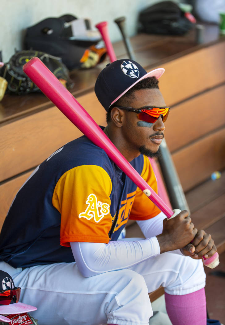 Aviators shortstop Jorge Mateo (14) watches his teammates from the dugout as they face the Taco ...