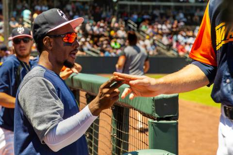 Aviators shortstop Jorge Mateo (14) encourages his teammates from the dugout as they face the T ...