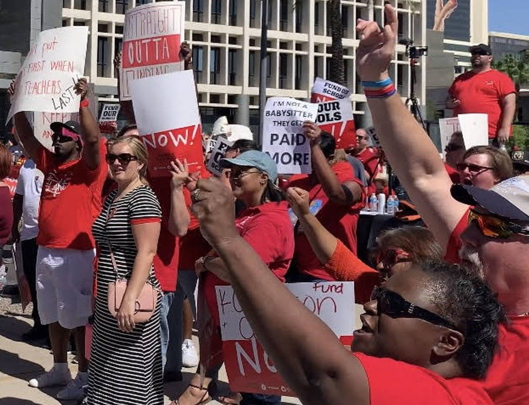 Thousands of educators, parents and students gather to rally to secure additional education fun ...