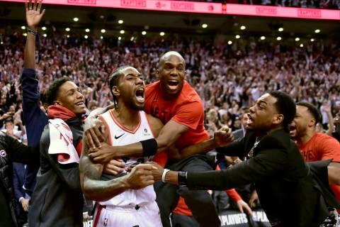 Toronto Raptors forward Kawhi Leonard, second from left, celebrates his game-winning basket as ...