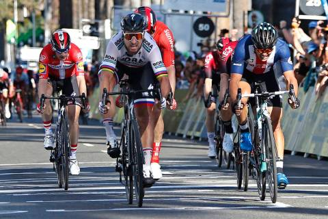 Peter Sagan, of the Bora-hansgrohe team, second from left, crosses the finish line ahead Travis ...
