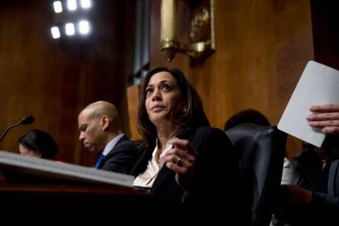 Sen. Cory Booker, D-N.J., left, and Sen. Kamala Harris, D-Calif., center, listen as Attorney Ge ...