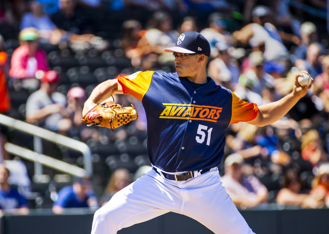 The Aviators pitcher Kyle Lobstein (51) winds up for another throw versus the Tacoma Rainiers a ...