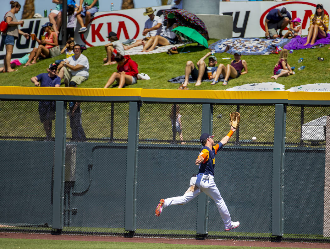 The Aviators Skye Bolt (8) misses a deep fly ball in right field hit off the wall by the Tacoma ...