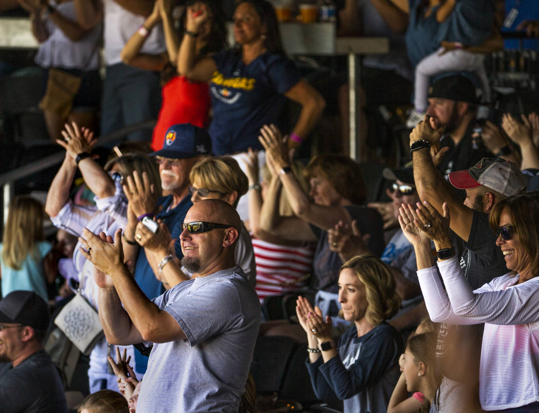 Aviators fans celebrate a grand slam late in the game versus the Tacoma Rainiers at the Las Veg ...
