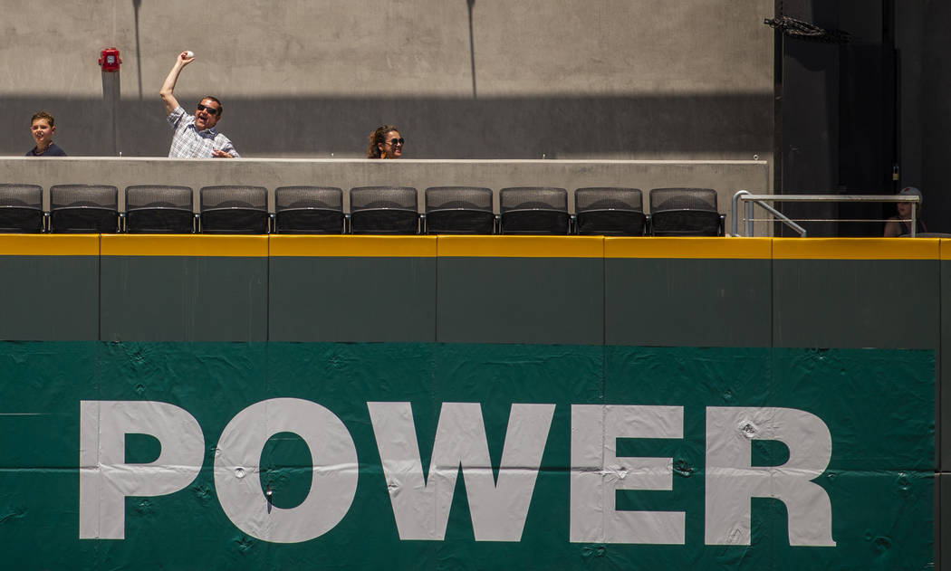 An Aviators fan shows off the ball he snagged which was hit over the wall in center field durin ...