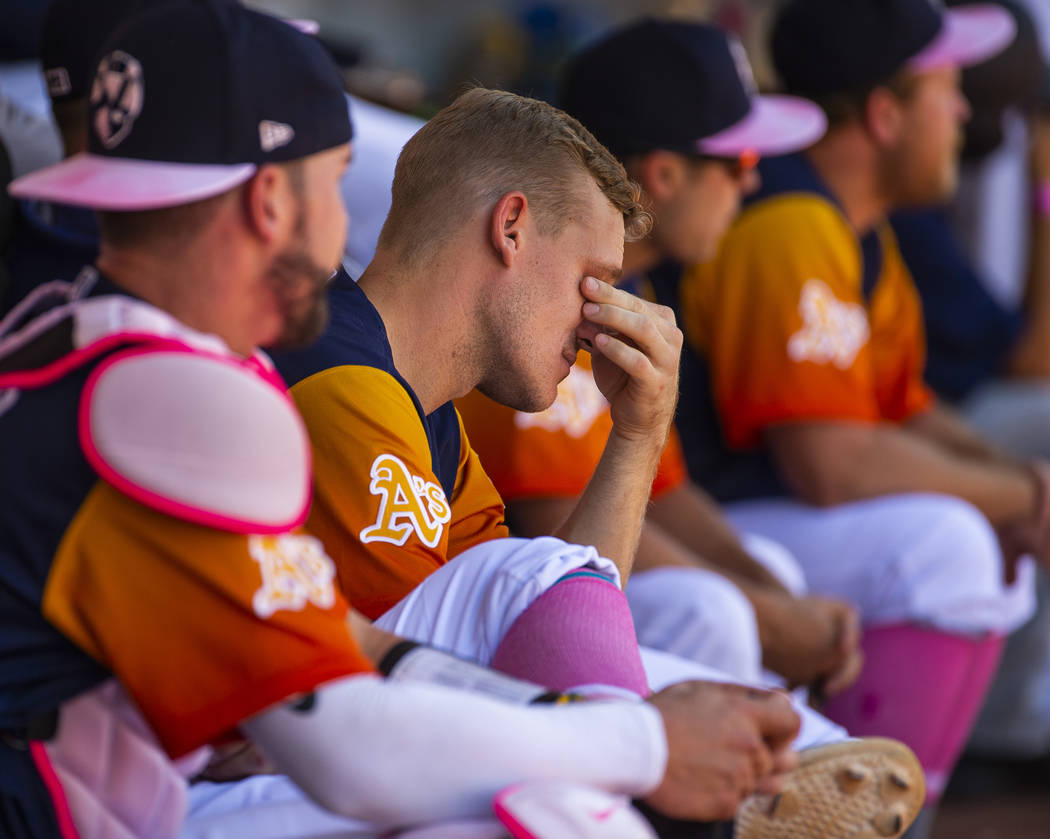 The Aviators Corban Joseph (5) is feeling the strain of a possible loss while in the dugout dur ...