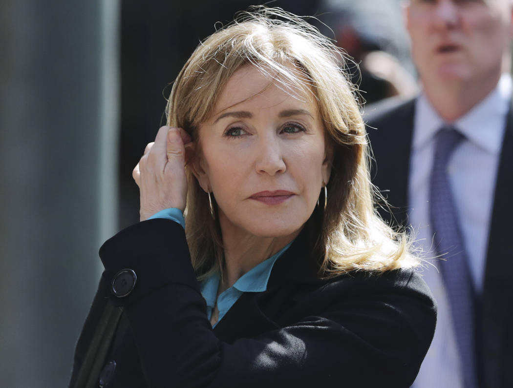 FILE - In this April 3, 2019 file photo, actress Felicity Huffman arrives at federal court in B ...