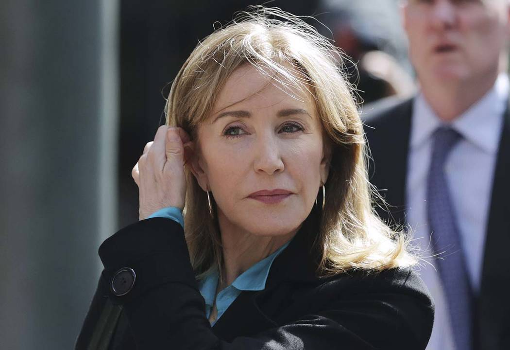 Actress Felicity Huffman arrives April 3, 2019, at federal court in Boston to face charges in a ...