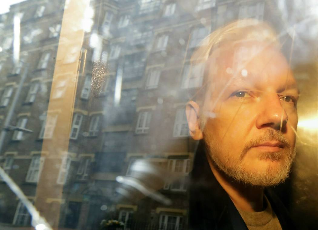 FILE - In this Wednesday May 1, 2019 file photo, buildings are reflected in the window as WikiL ...