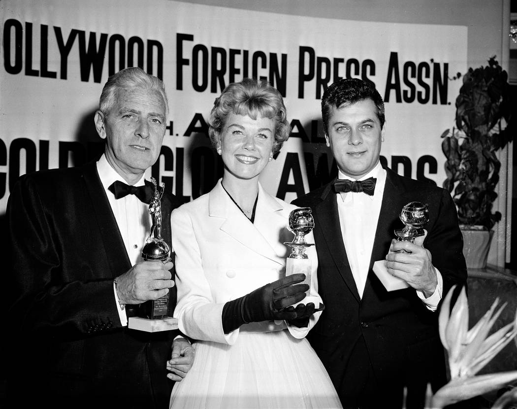 Actress Doris Day, with Tony Curtis, right, and Buddy Adler pose with their awards presented to ...