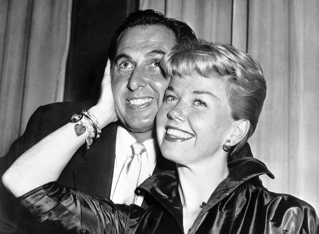 film actress and singer Doris Day poses with her husband and agent Martin Melcher at their hote ...