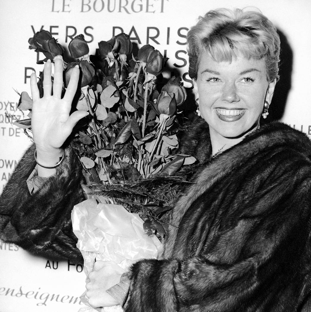 Actress and singer Doris Day holds a bouquet of roses at Le Bourget Airport in Paris, April 15, ...