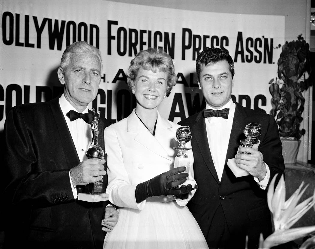 Actress Doris Day, center, Tony Curtis, right, and Buddy Adler pose with their awards presented ...