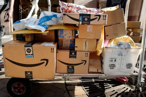 In this Oct. 10, 2018, file photo Amazon Prime boxes are loaded on a cart for delivery in New Y ...