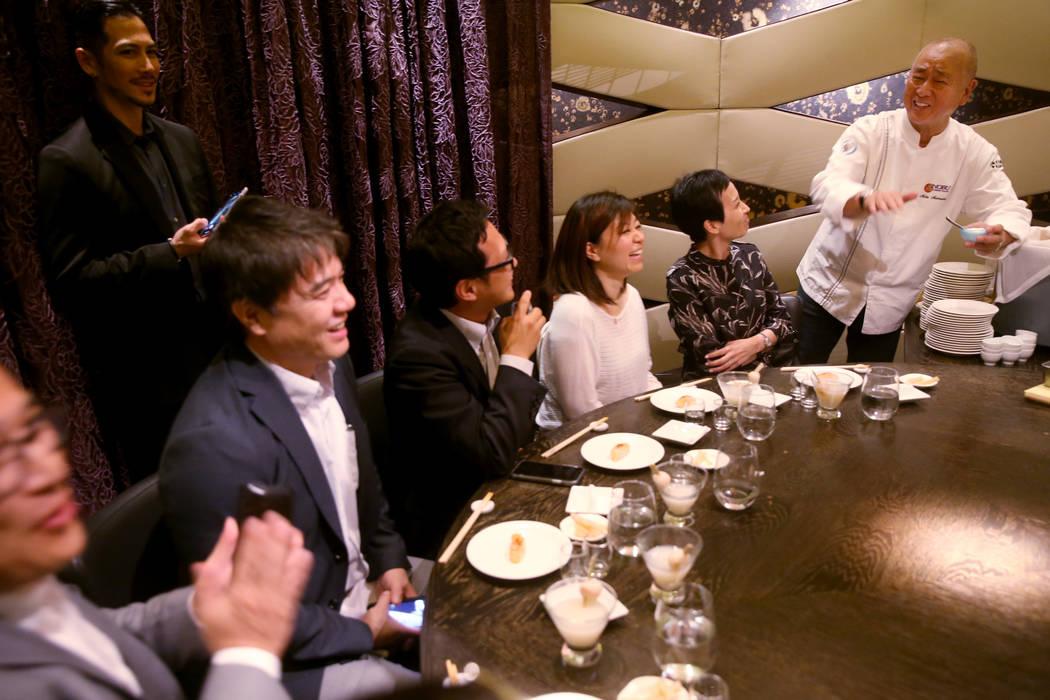 Chef Nobu Matsuhisa makes sushi during Master Series: Beyond the Blade with Chef Nobu Matsuhisa ...